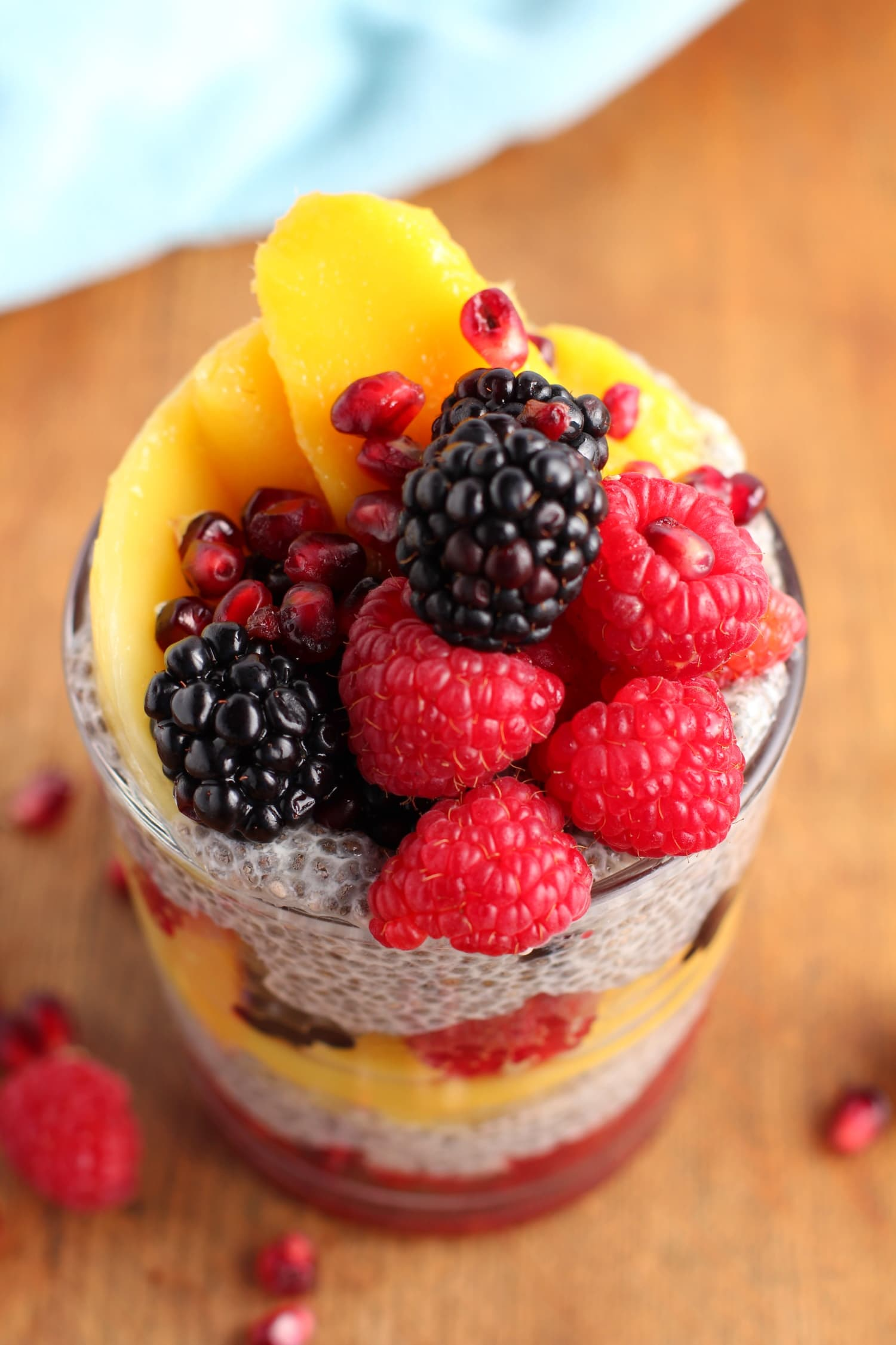 Chia seed pudding with mango berries and pomegranate