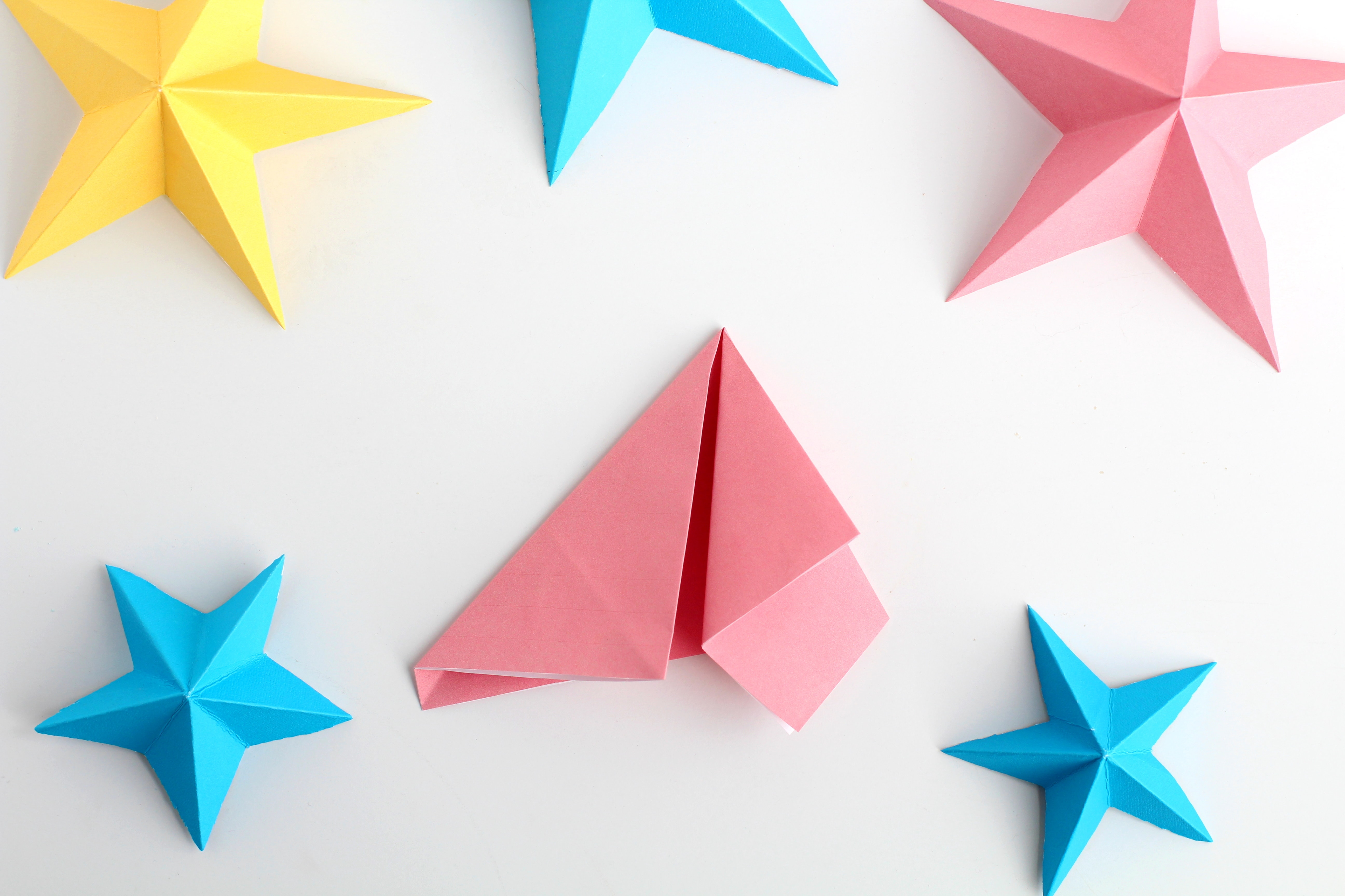 how to make 3D paper stars the easy way | fold both corners in